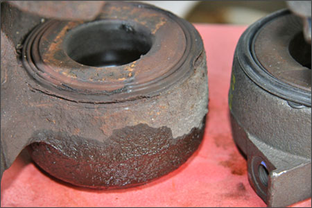 Rust and pieces of dust boot (left caliper in the photo) in the piston bores or the hairline cracks and scoring on the caliper pistons' surfaces