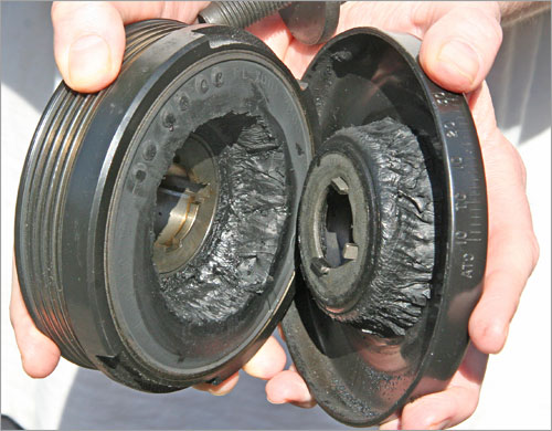 The rubber donut inside the Ford's harmonic balancer was ripped in two