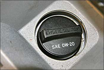 0W-20 oil weight specifications printed right on the oil filler cap