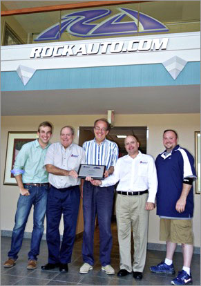 Pictured from left: RockAuto Product Manager Ben Sobczak, Auto 7 Senior Vice President Jim Murphey, RockAuto President Jim Taylor, Auto 7 President Steven Kruss and RockAuto Supply Chain Manager David Williams.